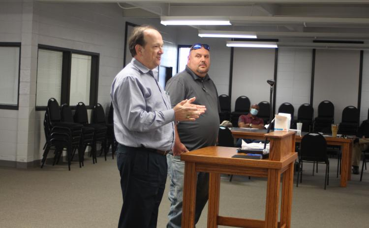 Megan Broome/The Clayton Tribune. Eric Neese, of the engineering company Freese and Nichols, Inc., and Public Works Director Jason Walroup address Clayton council members Tuesday and give an update on the GDOT project to widen Highway 441.