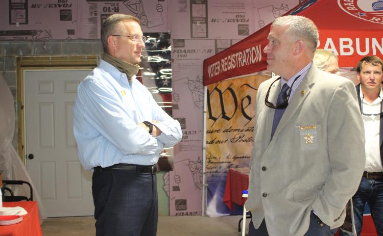 Megan Broome/The Clayton Tribune. Rep. Doug Collins talks with Sheriff Chad Nichols at a meet-and-greet held at the Rabun County Republican Party headquarters last Saturday. Collins is vying for a United States Senate seat and Nichols is running for reelection.