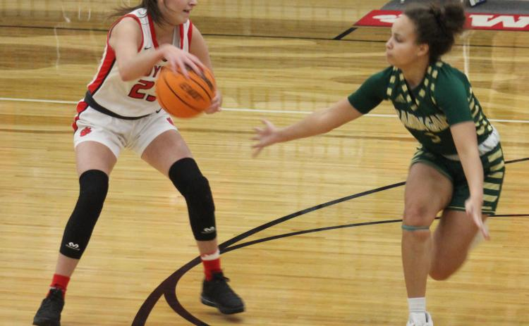 Andy Diffenderfer/The Clayton Tribune Mia Wilson of Rabun Gap-Nacoochee defends Rabun County's Gracie Deetz last Thursday.