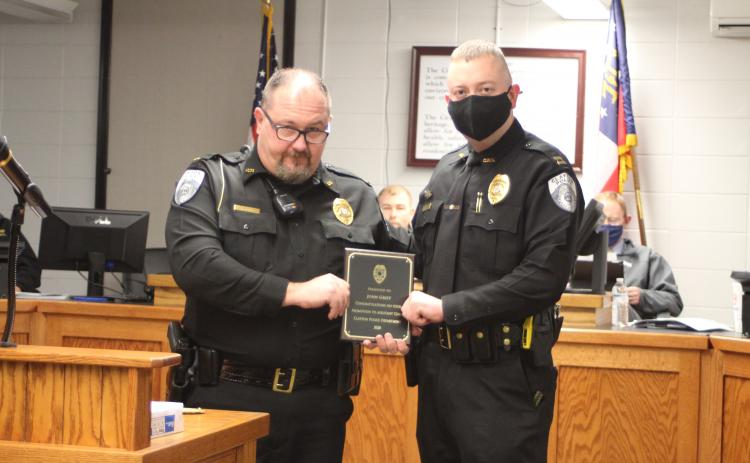 Megan Broome/The Clayton Tribune. Clayton Police Chief Andy Strait congratulates new Assistant Police Chief John Grist.
